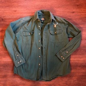 green button down shirt with deer patch